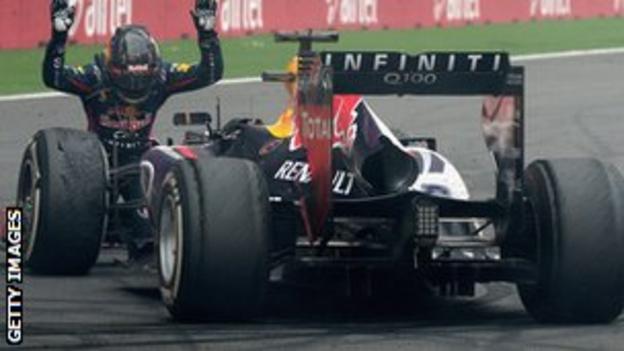 Sebastian Vettel celebrates with his Red Bull car