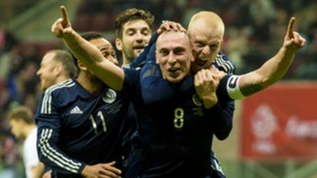 Scotland captain Scott Brown is congratulated following his winner against Poland