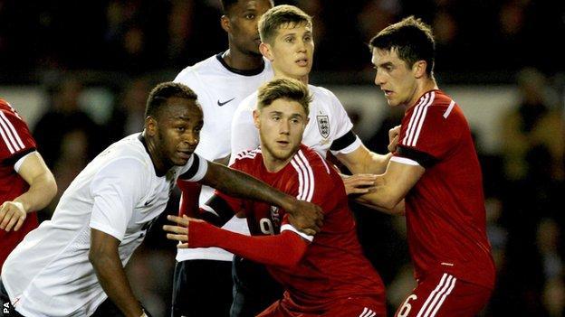 England's Saido Berahino (left) and Wales Wes Burns