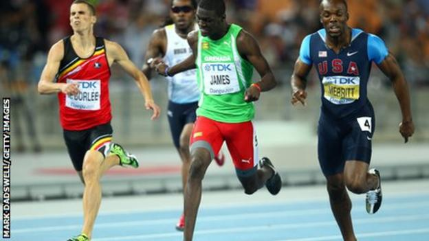 """Kirani James (centre) of Grenada crosses the finish line ahead of LaShawn Merritt (R) of United States and Kevin Borlee of Belgium (L) in the men""""s 400m final at the IAAF World Athletics Championships in 2011"""