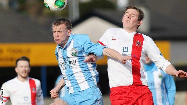 Warrenpoint's Towm Liam Bagnall beats Ross Arthur of Ards to the high ball