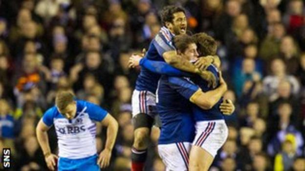 Duncan Weir cannot bear to look as France celebrate at the final whistle