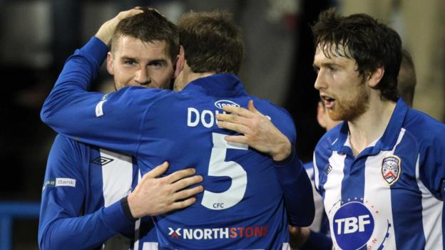 Stephen Lowry is congratulated after scoring Coleraine's goal in their 1-0 win over Crusaders at the Showgrounds