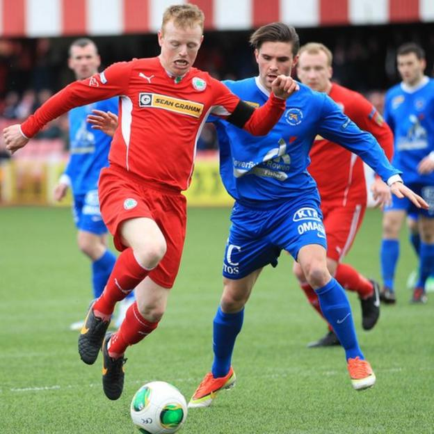 George McMullan in possession against Danny Keohane during Cliftonville's 5-0 win over Ballinamallard United