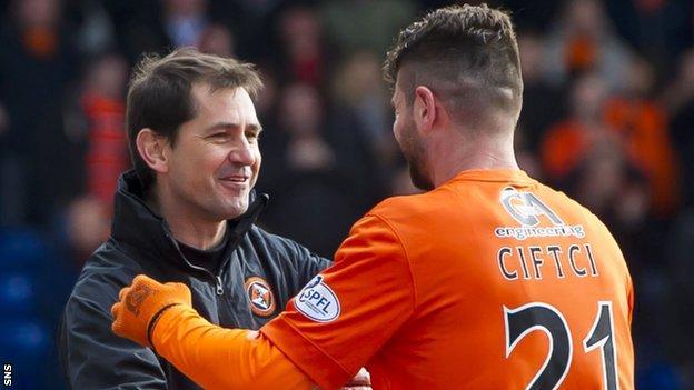 Jackie McNamara congratulates goal-scorer Nadir Ciftci as Dundee United beat Inverness 5-0