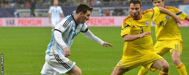 Lionel Messi in action against Romania