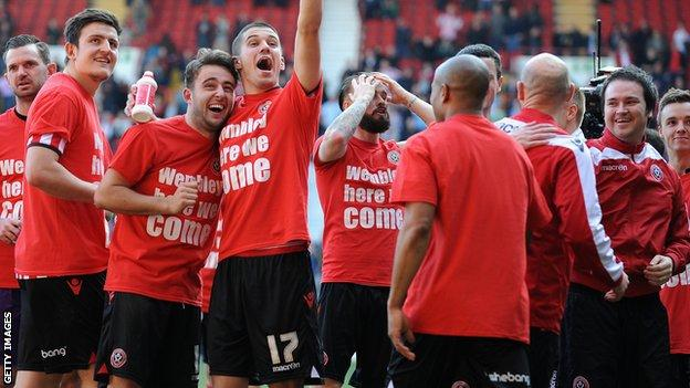 Sheffield United players celebrate reaching the FA Cup semi-finals