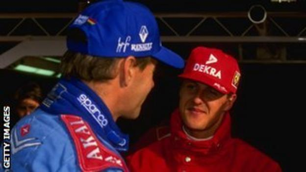 Gerhard Berger (left) and Michael Schumacher in discussion during their racing days