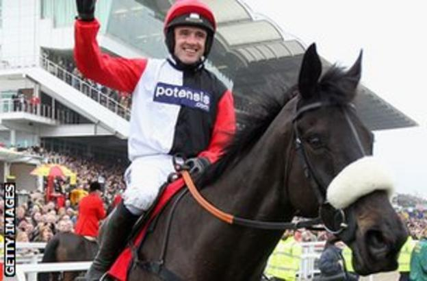 Ruby Walsh celebrates after winning the 2012 World Hurdle on Big Buck's
