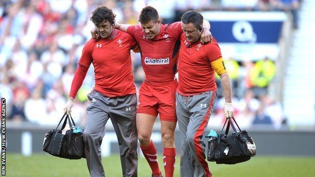 Wales' Rhys Webb leaves the field injured