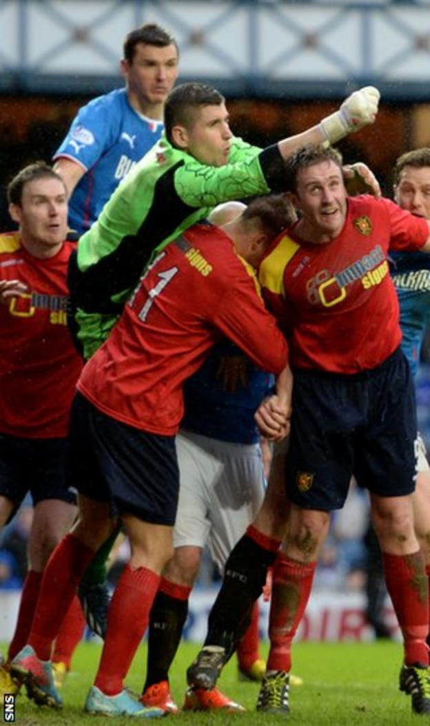 Albion Rovers goalkeeper Neil Parry punches clear