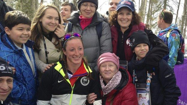 Tatyana Mcfadden of United States, second left in the first row, poses with her Russian birth mum, second right in the first row, after her race during the 12km cross country race