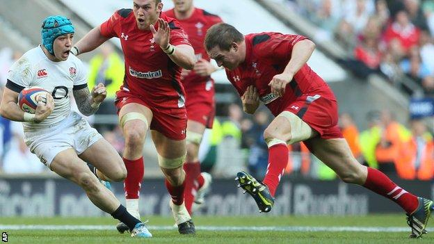 England wing Jack Nowell tries to avoid charging Wales prop Gethin Jenkins