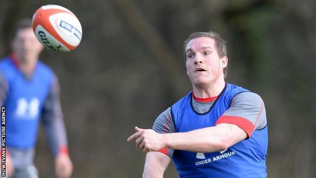 Gethin Jenkins throws a pass during a Wales training session