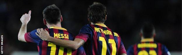 Barcelona's Argentinian forward Lionel Messi (L) is congratulated by his teammate Barcelona's Brazilian forward Neymar da Silva Santos Junior after scoring during the Spanish league football match.