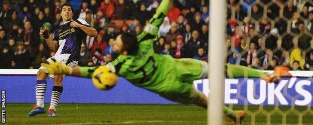 Luis Suarez scores against Stoke