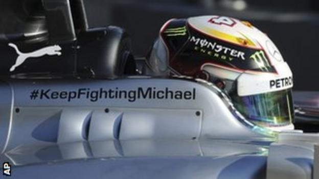 A message of support for Michael Schumacher adorns the side of Mercedes driver Lewis Hamilton's car