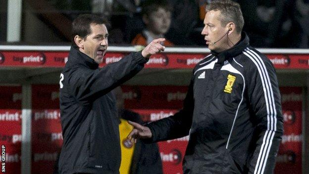 Jackie McNamara gesticulates in front of fourth official Iain Brines