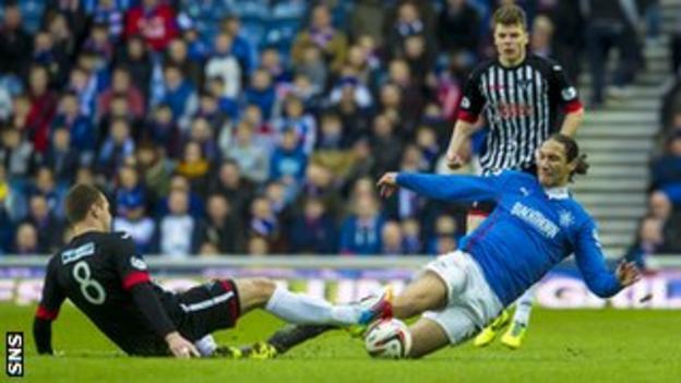 Dunfermline's Stephen Husband and Rangers' Bilel Mohsni battle for the ball