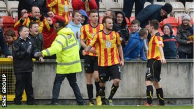 Kallum Higginbotham celebrates scoring Thistle's third goal