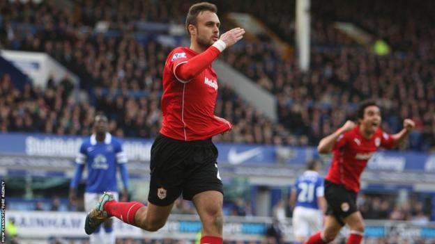 Cardiff City defender Juan Cala celebrates after cancelling out Gerard Deulofeu's deflected effort for Everton.