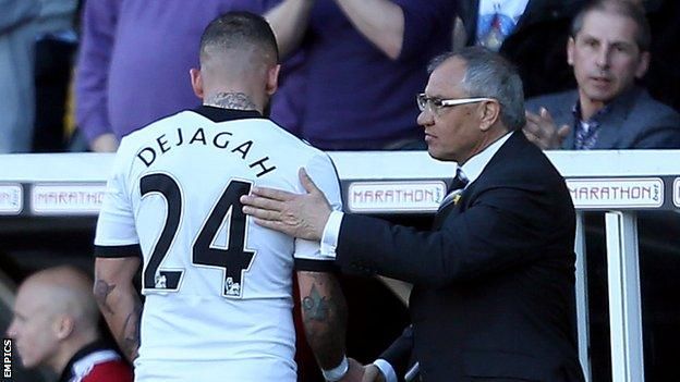 Fulham boss Felix Magath (right) shakes hands with Ashkan Dejagah, who scored the winner against Newcastle