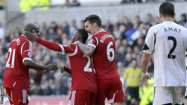 Stephane Sessegnon of West Brom celebrates his equaliser with Youssouf Mulumbu and Liam Ridgewell against Swansea