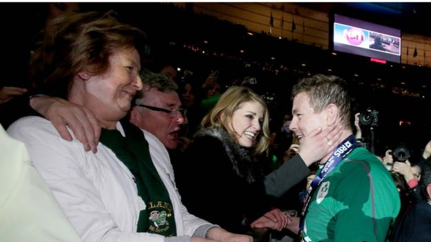 Man-of-the-match Brian O'Driscoll is congratulated by mother Geraldine and wife Amy after his emotional farewell game in Paris