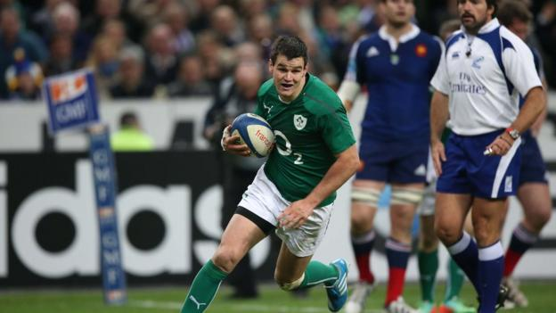Irish fly-half Jonathan Sexton prepares to touch down for the second of his two tries