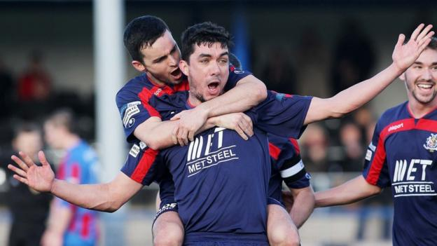 Portadown players congratulate Emmett Friars after he scores the winning goal against Ards at Clandeboye Park