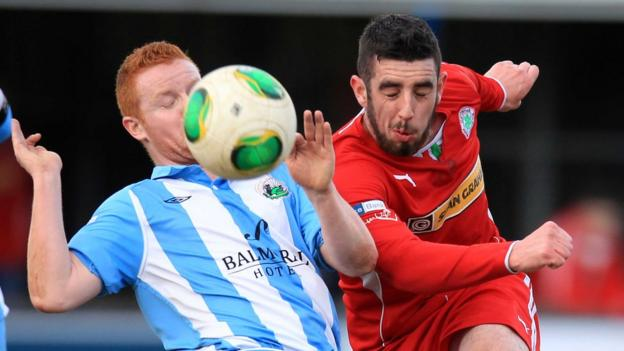 Stephen Moan and Joe Gormley in action as Cliftonville defeat Warrenpoint Town 2-0 at Stangmore Park