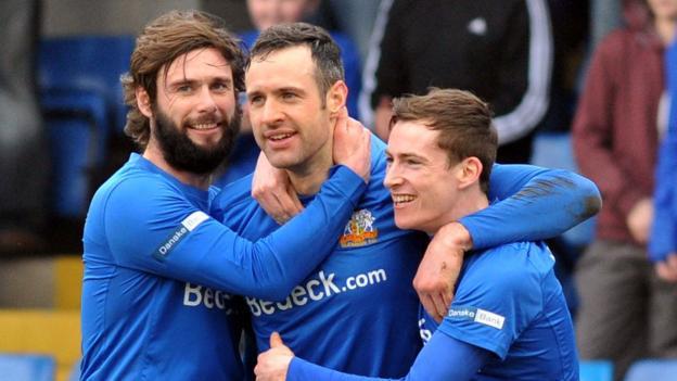 Glenavon player-manager Gary Hamilton congratulates Ciaran Martyn after his second goal ensured a 3-1 win over Coleraine