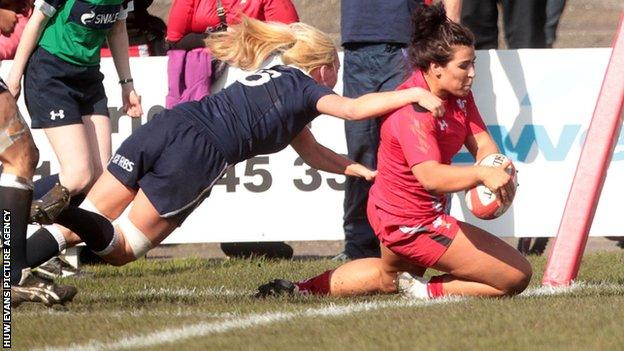 Shona Powell-Hughes scores a try for Wales against Scotland