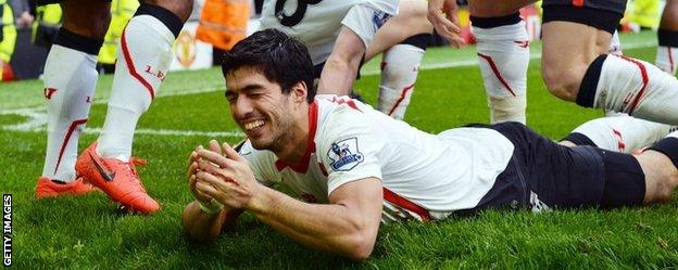 Luis Suarez celebrates after the full-time whistle
