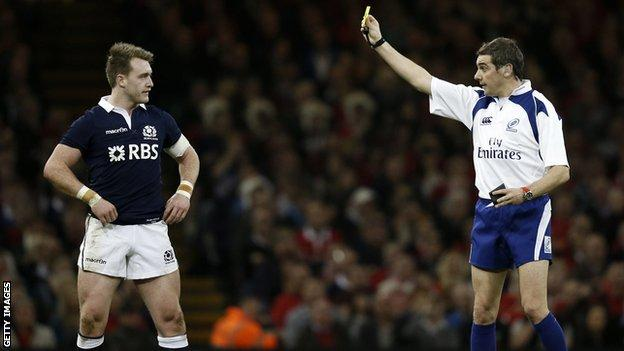 Stuart Hogg is shown the yellow card