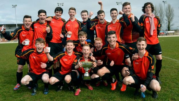 The De La Salle team celebrate after winning beating St Mary's in the Belfast Senior Cup final at New Grosvenor