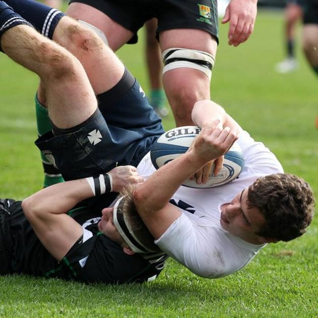 Methodist College centre Alastair McKee scores his side's third try during the Schools' Cup final against Sullivan Upper
