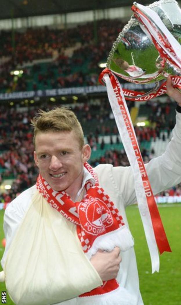 Aberdeen winger Jonny Hayes celebrates at Celtic Park