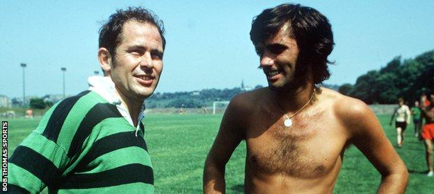 McGuinness chats to George Best during a United training session