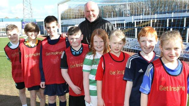 Chick young with pupils from All Saints Primary School