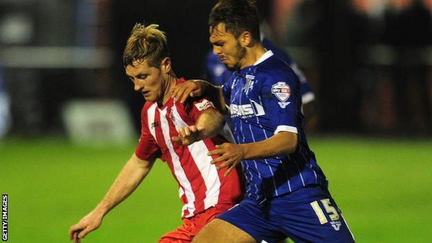 Gillingham's Bradley Dack (r) and Gary Mulligan of Brackley Town