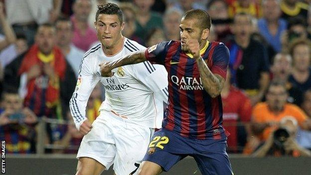 Real Madrid's Cristiano Ronaldo (left) and Barcelona's Dani Alves