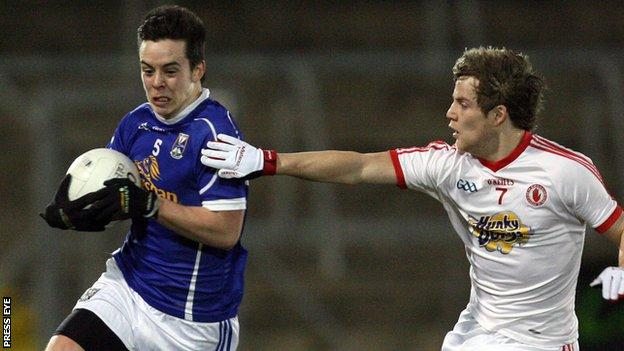 Cavan's Gerry Smith is challenged by Kieran McGeary of Tyrone