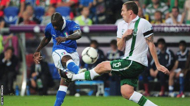 Richard Dunne tries to block a Mario Balotelli shot at the Euro 2012 game between Italy and the Republic of Ireland