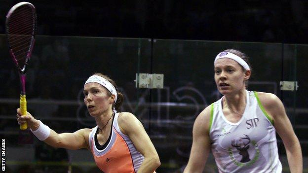 Madeline Perry (left) battles with England's Sarah-Jane Perry in their second-round match at the World Championships