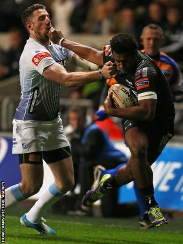 Aisea Natoga hands off Blues' Alex Cuthbert to score Ospreys' second try