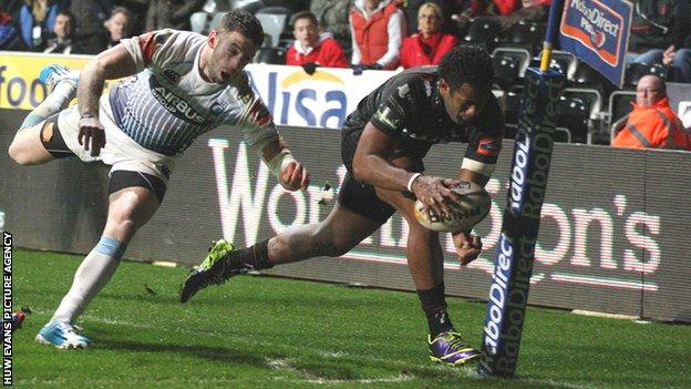 Aisea Natoga crosses for his third try against Cardiff Blues with Alex Cuthbert trailing in his wake