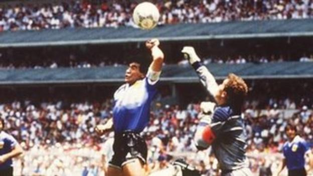 Argentina's Maradona uses his hand to beat England's Peter Shilton to the ball
