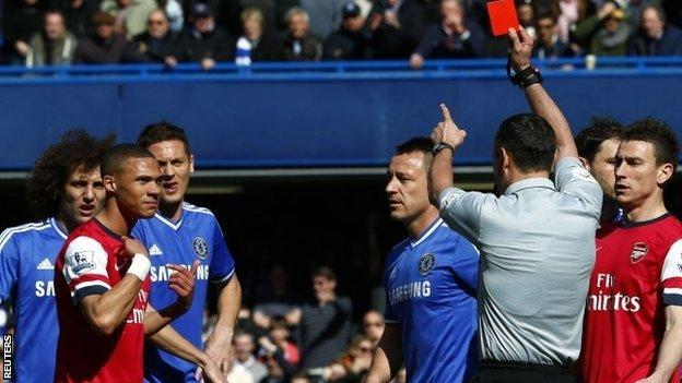 Kieran Gibbs is wrongly sent off against Chelsea