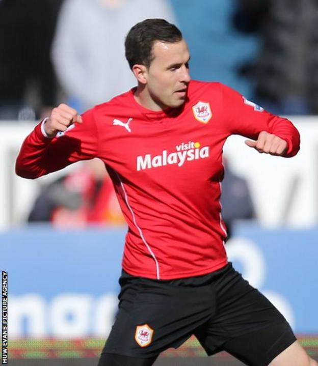 Cardiff City's Jordon Mutch celebrates after giving his side a ninth minute lead against Liverpool in the Premier League at Cardiff City Stadium.